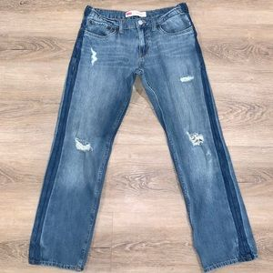 Vintage Levi 551 slim jeans with distressing